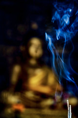 Stuck in Aromatic (Carl's Captures) Tags: smoke plumes incense sticks smoking buddha watdoikukham วัดดอยกู่คำ temple chiangmaiprovince hangdong northernthailand asia thai siam reverence faith belief religion spirituality culture tradition statue art icon deity divine divinity worship fire flame mystery dof bokeh blue gold golden scent fragrance aromatic meditation prayer aroma buddhism swirls indoors altar mood atmosphere mystical aura nikond5100 tamron18270 photoshopbyfehlfarben thanksbinexo