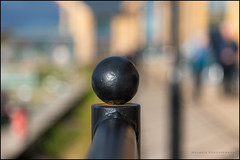 Railing bokeh (G. Postlethwaite esq.) Tags: dof derbyshire merciamarina ball beyondbokeh bokeh depthoffield photoborder railing selectivefocus willington findern