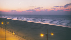 unexpected sky's colors (TheManWithTheGoldenEye) Tags: sea sunset colors cloud belgium light color belgique belgie vintage blur film tones grain noise