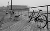 Asbury Park Boardwalk (Dalliance with Light (Andy Farmer)) Tags: jersey beach ocean boardwalk asburypark water conventionhall bicycle bw nj sand shore newjersey unitedstates us