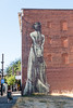 Street Art - Portland, Oregon (UrbanphotoZ) Tags: redbrick wall streetart urbanart woman gown back longgown longhair monochrome capaxinfiniti carlylebuilding faith47 southafrican portland oregon aniabridal potholehotline vacantlot brickedupwindows