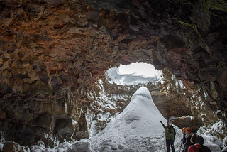 Anna the guide talks about the first skylight inside the lava tunnel at Raufarholshellir, Iceland