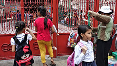 School Gate (CAMBODIA) (ID Hearn Mackinnon) Tags: phnom penh cambodia cambodian 2017 school gate band practise red after south east asia asian mother kids children students khmer culture society city urban
