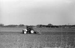 Deep plowing (odeleapple) Tags: leica lllf elmar 5cm kodaktmax100 film monochrome tractor deep plowing field