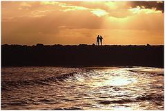 Lovely Silhouettes (kurtwolf303) Tags: sundown sunset sky water waves clouds wolken orange persons people silhouette ocean sea mare gegenlichtaufnahme backlightedshot scherenschnitt unlimitedphotos topf25 topf50 250v10f topf75 topf100 contraluz