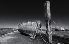 Going nowhere (David Feuerhelm) Tags: nikkor boat rope post wideangle lowviewpoint blackandwhite monochrome bw noiretblanc schwarzundweiss contrast coast pinmill suffolk england silverefex nikon d750 1635mmf4