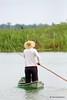 El día a día (castellanosfenix04) Tags: pescador agua persona humedal redes canoa madera hierba vegetación sombrero