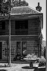 CENTURY 21 (LA GRANDE TERRE) Tags: australia bw blackwhite building canon century21 easternsuburbs efs1855mmf3556isii eos1300d monochrome newsouthwales nsw photoshopcc randwick randwickjunction realestate sandstone scooter sydney