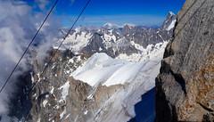 View from Téléphérique Aiguille du Midi. Descending to mid station Le Plan de l'Aiguille. (elsa11) Tags: aiguilledumidi leplandelaiguille montblancmassif chamonix hautesavoie rhonealps ridgevalléeblanche glacier gletscher france frankrijk alps alpen mountains snow sneeuw gletsjer valléeblanche