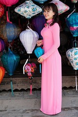 A Vietnamese woman in a traditional ao dai posing with a Vietnamese lanterns,  Hoi An, Vietnam (adamba100) Tags: asia asian china chinese korea korean mongolia mongolian vietnam vietnamese thai beijing town city view landscape cityscape street life lifestyle style people human person man men woman women male female girl boy child children kid interesting portrait innocent cute charm pretty beauty beautiful innocence play face headshot pure purity tourism sightseeing tourist travel trip light color colour outdoor traditional cambodia cambodian phnom penh sony a6300 18105 siem reap pattaya bangkok field gate architecture tree building