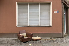 Please take a seat #616 (österreich_ungern) Tags: seat armchair brown collection facade frontal window closed jalousie torn signs shades grey tristesse öde dull berlin neukölln dirt full polster leather leder braun cigarettes