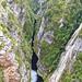 Gordon Dam,Tasmania, the deep cleft in between the rocky mountain down stream (PsJeremy - back and catching up...) Tags: hydro australia tasmania gordondam gorge ravine explore