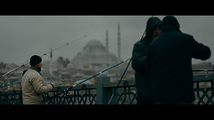 Galata Bridge, Istanbul (emrecift) Tags: candid portrait landscape cityscape photography cold blue istanbul fisherman cinematic 2391 anamorphic grain nikon d600 nikkor 85mm f18g emrecift