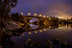 Mirror Bridge (Jens Haggren) Tags: bridge evening reflections lights rocks water skurubron skurusundet sky samyang75mm olympus em1 le longexposure nacka sweden jenshaggren