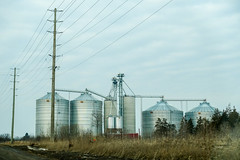 All in a Row (gabi-h) Tags: silos industrial quintewest row gabih architecture lines texture powerlines hydropoles