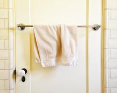 Solitude Takes Time (Maureen Bond) Tags: ca maureenbond handtowel bathroom guestbathroom yellow vintage towelbar tile doorknob lock friendshouse