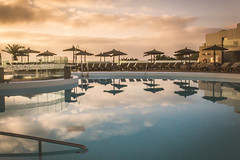 I'm missing this weather! (Ian Emerson Thanks for the comments and faves) Tags: hotel lanzarote pool parasol reflection morning sunrise