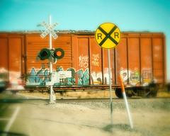 The right train of thought can take you to a better station in life (Maureen Bond) Tags: lights train railroad crossing tracks signs car waiting tagging graffiti gotstuckrightatthetrack ca maureenbond desert