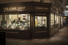 Dayhawks (Reckless Times) Tags: nighthawks dayhawks art poster oxford covered coveredmarket cake shop indoors leading line working work food nikon photography d750 100x 50mm 500px