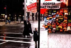 Women in the rain, Washington DC, December 1997.  NB: Note taped to parking meter. (brunofish) Tags: c copyrighted material brian fish aka brunosih cbrunofish