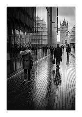 More London (Dave Fieldhouse Photography) Tags: streetphotography street london city urban citycentre offices cbd rain weather blackandwhite monochrome mono pedestrian pavement tower towerbridge landmark fuji fujifilm fujixpro2 fujinon35mmf2 wwwdavefieldhousephotographycom people reflections wet england greatbritain town hall cityhall morelondon icon portrait