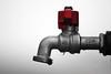 Wet (jimiliop) Tags: tap drops selectivecolour red monochrome closeup silver focus 50mm water