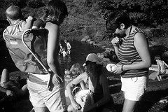 Hot summer of 1983 (mr broddy) Tags: pîcnic summer hot swim river hebdenbridge baby woman rock stone water children grass tree yorkshire babycarrier shorts dam blakedean event hippie