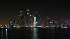 Dubai Marina...(1) (John Konstandis) Tags: canoneos5dmarkiii canonef1635mmf4lisusm dubai unitedarabemirates uae dubaitowers dubaimarina palmjumeirahisland skyscraper tower nightindubai nightphotography night longexposurephotography water