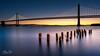 Sunrise at the Bay Bridge (Visualvalhalla) Tags: bay baybridge sanfrancisco sunrise water backlight longexposure pier sun sunbeam embarcadero
