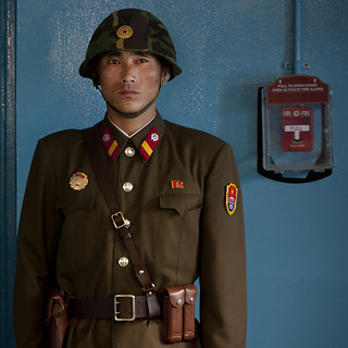 North Korean soldier wearing an helmet standing in front of the United Nations conference rooms on the demarcation line in the Demilitarized Zone, North Hwanghae Province, Panmunjom, North Korea