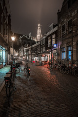 Night Light (McQuaide Photography) Tags: haarlem noordholland northholland netherlands nederland holland dutch europe sony a7riii ilce7rm3 7rm3 alpha mirrorless 1635mm sonyzeiss zeiss variotessar fullframe mcquaidephotography lightroom adobe photoshop tripod manfrotto night nacht nightphotography stad city urban lowlight architecture outdoor outside illuminated street straat warmoesstraat window wideangle wideanglelens groothoek building longexposure oldstreet old oud character traditional authentic streetlight atmosphere sfeer winter emptystreet deserted nopeople cobblestone cobbles metzo restaurant shadow light licht portrait grotekerk sintbavokerk church kerk