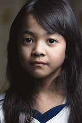 Low key shot of little asian girl in black & white (Patrick Foto ;)) Tags: 67 abuse alone asian b bangkok black blank blue bullied camera child childhood chin close depressed down expression eyes face female girl horizontal indoors infant innocence issues key lonely looking low model neglect nine old pensive people portrait problem sad social studio thai thailand thinking troubled up upset w white year years young