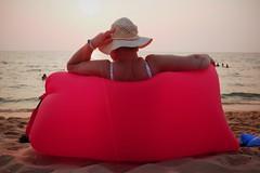 Inflated Tourism, Vietnam (polybazze) Tags: vietnam asia phuquoc longbeach russian woman pillow pink red fat fujifilm fuji x100t fujifilmx100t sun sunset tropics