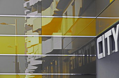 reflection in yellow (christikren) Tags: yellow citygate austria christikren architecture building grey reflection urban lines abstract glass metal reflets