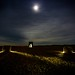 Nocturnal Haybales #13: The Sailing Bales of Buchan (john&mairi) Tags: nocturnal haybales buchan lightpainting figure silhouette me moon cloud night sky rain waterlogged lighttrail sailing stones death valley watertower