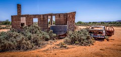Once Upon a Time (*ScottyO*) Tags: silverton brokenhill nsw australia desert outback rural remote landscape pano panorama panoramic car vehicle tank house stone chimney windows shrubs rust decay red dirt blue history historic doors abandoned horizon sky shell home cottage