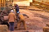 True Grit! (a2roland) Tags: normanzeba2rolandyahoocoma2roland railway construction workers working hard true grit yellow sunny sunlight bright sunshine shovel machinery tracks trains mud dirt landfill land hardhat overhaul engineers people digging dig build camera nikon focus