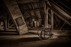 old abandoned wheelchair under the roof - sepia (Peter's HDR-Studio) Tags: petershdrstudio hdr abandoned lostplace verlassen verlasseneplätze sepia attic dachboden