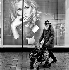 Sceptical (Leonegraph) Tags: panasonic1235mmf28 mft micro43 microfourthirds hanover monochrome einfarbig bw sw blanco negro bn schwarz weis black white leonegraph streetphotographer public öffentlich leben lebendig story urban photography spontan spontanious candid unaware unposed personen sitaution street 2017 europe europa germany deutschland bewegung blickgrade drausen eineperson gehen gesicht gx800 hannover mann nachtskunstlicht spiegelung