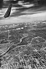 Calgary from Above 4 (LongInt57) Tags: landscape city sky clouds aerial aircraft airplane jet wing river prairie calgary alberta canada bw monochrome black white grey gray suburbs westjet airline bowriver