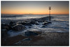 Cold Dawn on Caister Beach (Steven Docwra) Tags: caister east rocks sea clearsky sunrise dawn marker seascape landscape seadefenses nocloud colour nopeople wave rough nikon pce 24mm f35d ed