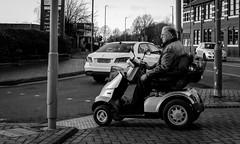 2018_048 (Chilanga Cement) Tags: fuji fujix100f x100f xseries bw blackandwhite monochrome man people chariot wheelchair street streetphotography wheel wheels ormskirk crossing pavement sidewalk shopping gentleman