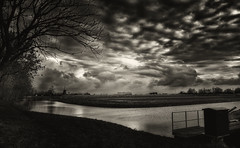Waiting For The Sun (Alfred Grupstra) Tags: blackandwhite nature water river england landscape outdoors cloudsky ruralscene uk sky scenics reflection cloudscape nopeople sunset dark farm tree monochrome