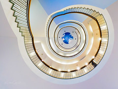 Approaching planet Earth (Karsten Gieselmann) Tags: 714mmf28 blau em5markii gelb mzuiko microfourthirds olympus treppe weis blue kgiesel m43 mft white yellow münchen bayern deutschland stairs staircase