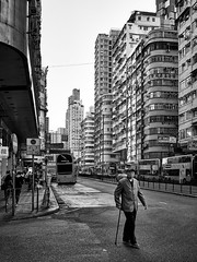 Dec 31, 2017 (pavelkhurlapov) Tags: mongkok bus oldman road crossing buildings cane corner people monochrome streetphotography city