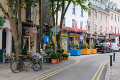 Cross Street, Galway (ho_hokus) Tags: 2017 crossstreet fujix20 fujifilmx20 galway ireland bicycle colorful colours flags shops stores street road bike shop