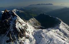 Mountain top (dragoku) Tags: alps mountaintop flight clouds sky mountain night tyrol
