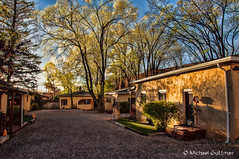 Spring Time Light in Taos (Michael Guttman) Tags: taos newmexico trees sunlight buildings driveway sky light nikon d90 spring adobe