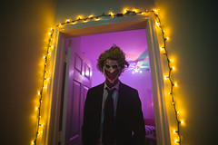 Halloween (BurlapZack) Tags: pentaxk1 pentaxfa20mmf28 vscofilm pack07 dallastx addisontx northdallas halloween halloweenparty costume costumes costumeparty availablelight handheld lowlight wideangle mask clown evilclown scary scaryclown spooky spoopy haunted murderer yellow purple doorway frame portrait