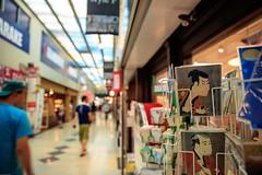 Three-Quarter View (Atomic Eye) Tags: nakano tokyo japan broadway street photography front sign paper line people tourist alley perspective nakanobroadway postcards tōshūsaisharaku otanionijiii kabuki postcard mall shopping bokeh yakkoedobe polychromewoodblockprint souvenir shop